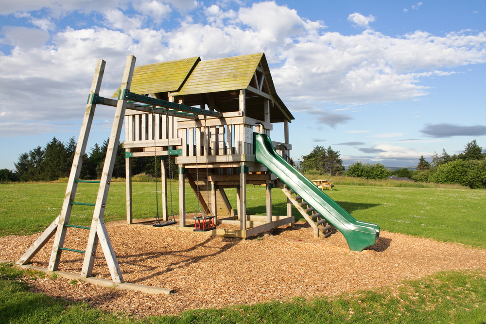 Create a Wonderful Playground in the Back Yard with a Custom Swing Set